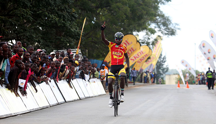 Race winner Bonaventure Uwizeyimana celebrates the victory